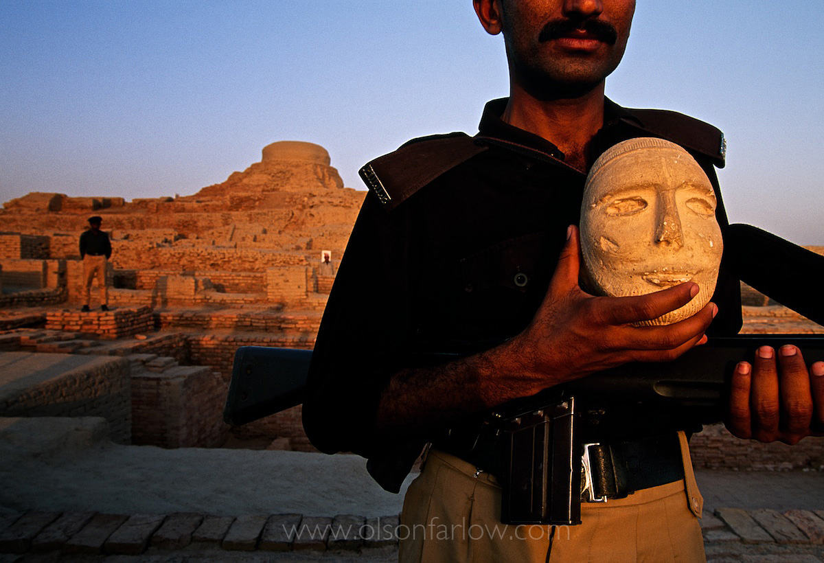 Guard at Mohenjo Daro Archaeology Site With Artifact in Sindh, Pakistan