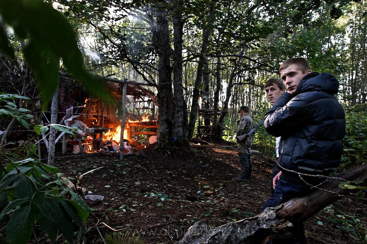 Poachers Watch Wardens Burn