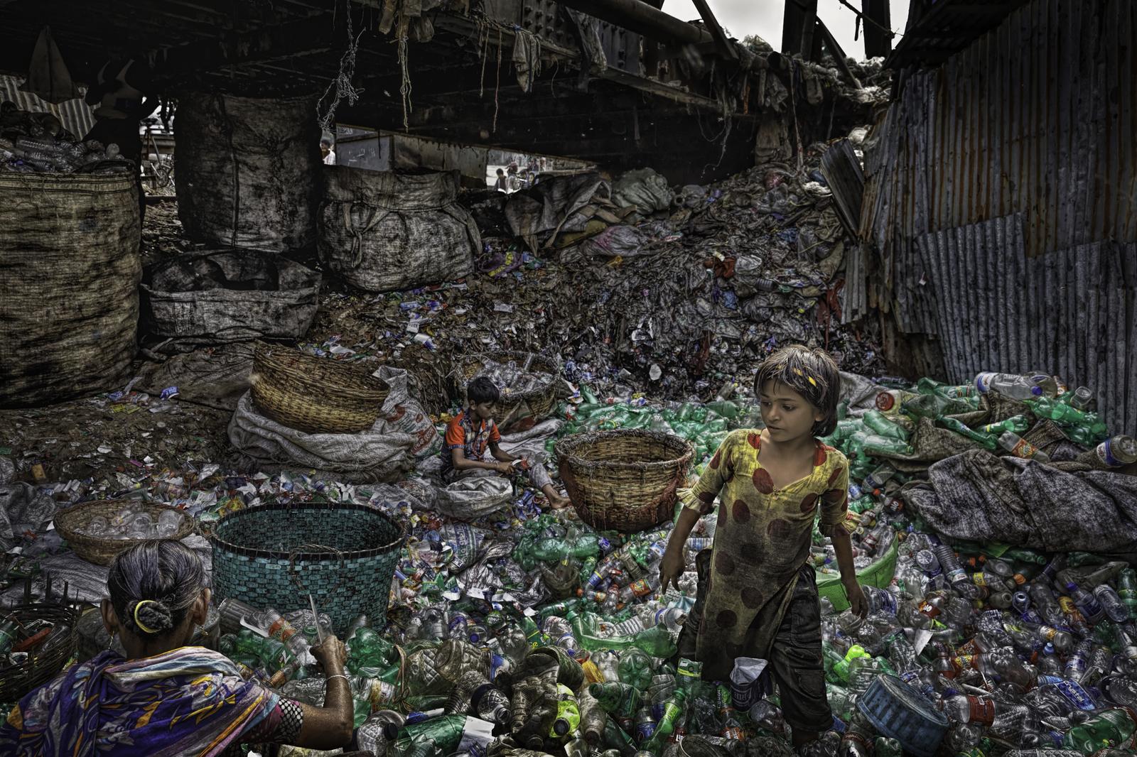 Family Sorts Plastic Under Bridge