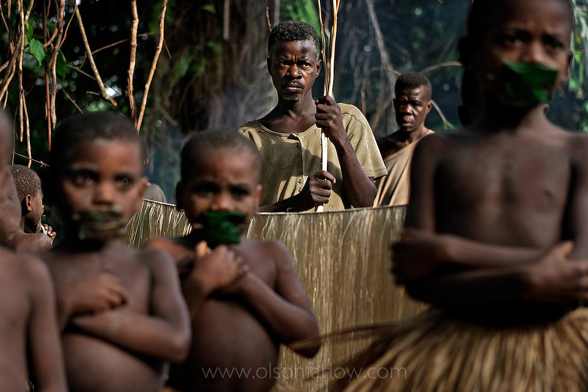 Trio of Pygmy Boys waiting for Whipping | Ituri Forest, DR Congo